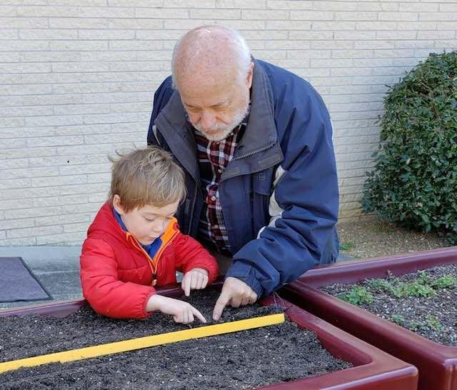 grandfather gardening with grandson